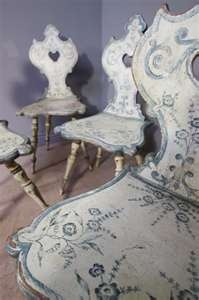Antique Alsatian pine chairs painted white with a pretty floral pattern