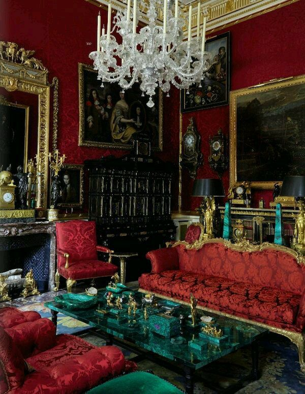 Sitting Room In Red With A Malachite Coffee Table And Antiques