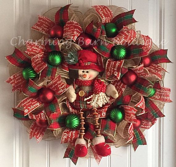 The adorable snowman is the perfect little guy to welcome all of your Christmas guests. Decorated with two different wired Christmas ribbons