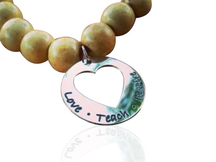 Personalised cut out heart bracelet. Wooden 10mm beads in various colours with Sterling Silver pendnats that can be personalised with names, words or dates.  Available at Sweet Sweet Silver