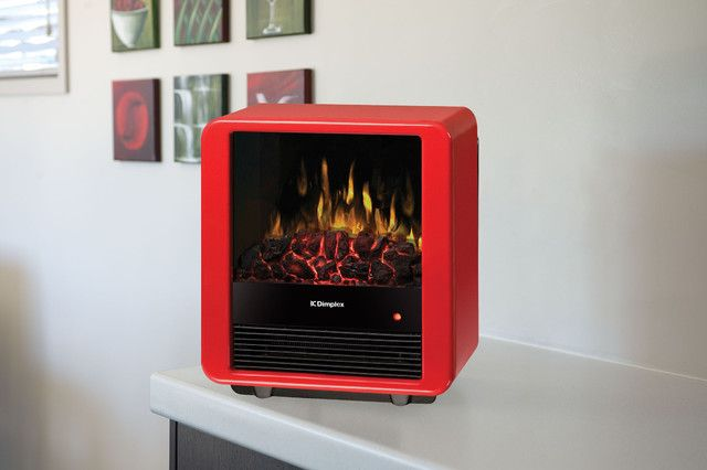 The Mini Cube Red 1.5kW Portable Electric Fire with Optiflame coal effect adds warmth and style to any roomw thanks to its clean, modern design, highlighted by a glossy finish and louvered front panel.
