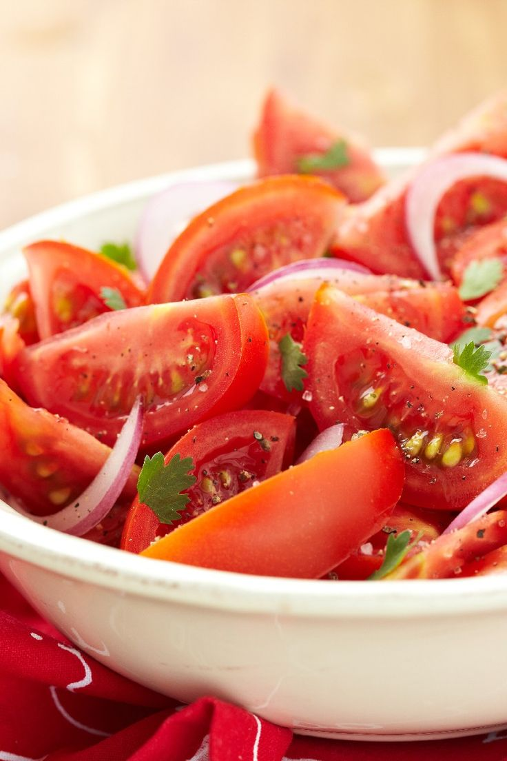 Chilean Salad Reicpe with Tomato, Onion and Coriander Leaves in a Simple Dressing. Full of flavor and it Takes Only Five Minutes to Prepare!