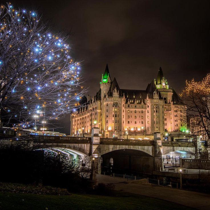 """""""Amber lights along the Rideau Canal by the NAC augment the beautiful Chateau Laurier as part of the lovely view of Canada's capital during the Christmas…"""""""