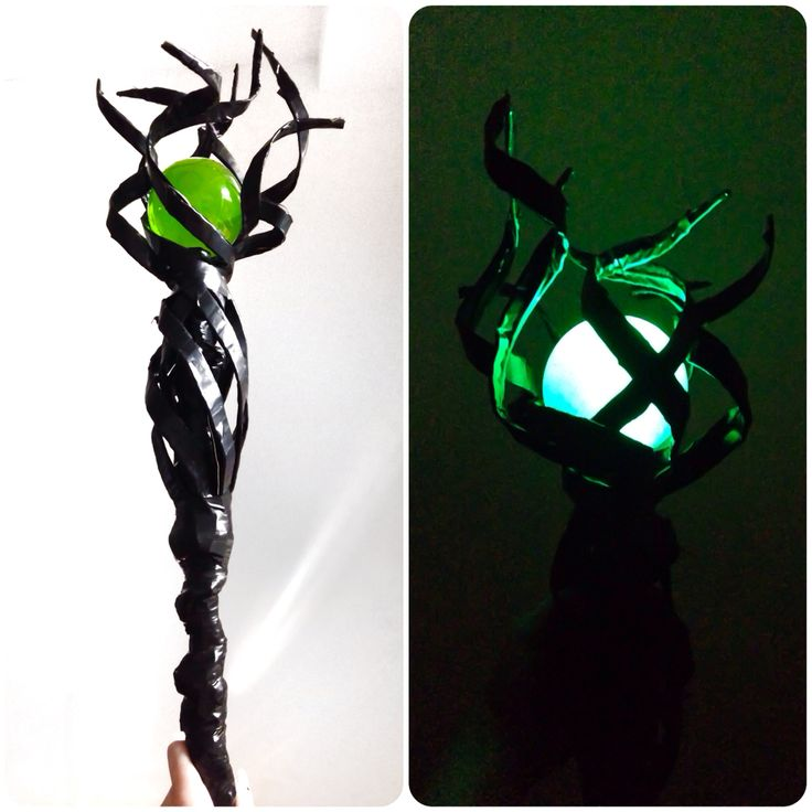 Finished Maleficent's scepter tonight. All made out of a broom rod, electrical tape, wire and cardboard. The glowing ball is thanks to my husband's brilliant mind who decided to fill the plastic ornament with dishsoap!! He also attached a light inside so that I can make it glow whenever I please. Team work!!