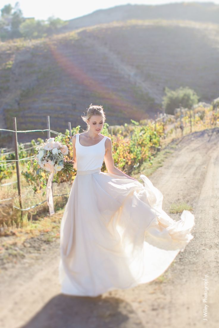 whimsical pink and white tanktop wedding dress