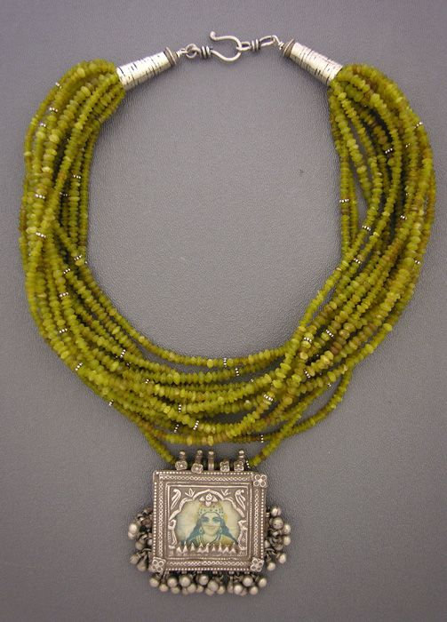 by Anne Holland |  Sixteen strands of tiny Afghani jadeite beads laced with sterling silver daisy  spacers hold a beautiful antique silver pendant from India.  |  Dorje Designs | 585$