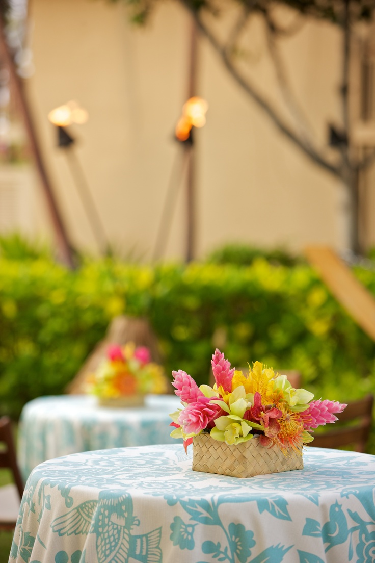 Simple, yet fun tropical flowers and linens for a luau party (from my wedding welcome party by Beth Helmstetter and flowers by Holly Flora)