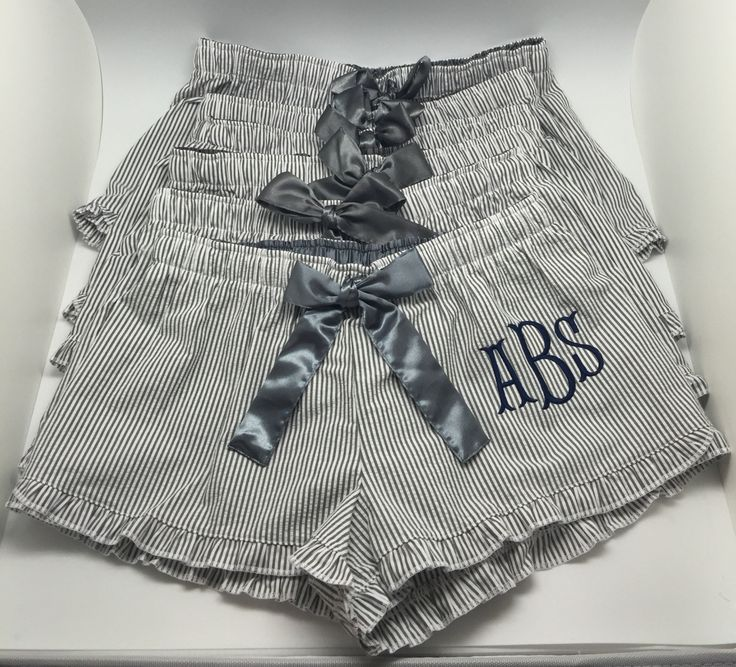 Lounge in style with our delicious monogram pajama shorts! Perfect gift for your bridal party. **SEND A CONVO FOR A DIFFERENT NUMBER THAN 8!*** IN A RUSH??? Send a convo and we will try to accommodate your request!  100% comfy cotton seersucker bitty shorts with ruffle at the hem, feature satin ribbon at elastic waist. We add a pretty monogram in your choice thread color and monogram style. Shown here: Navy Fishtail font on Grey shorts, Lavender Heirloom font on Grey Pants. Also available…