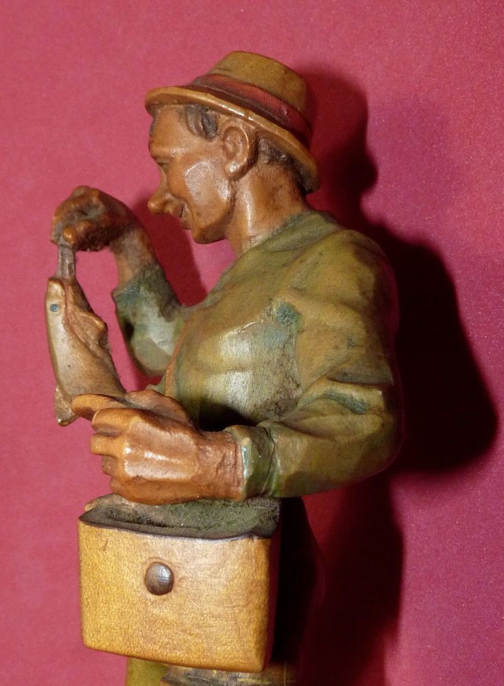 Fishing catching fish vtg hand carved german wood figurine