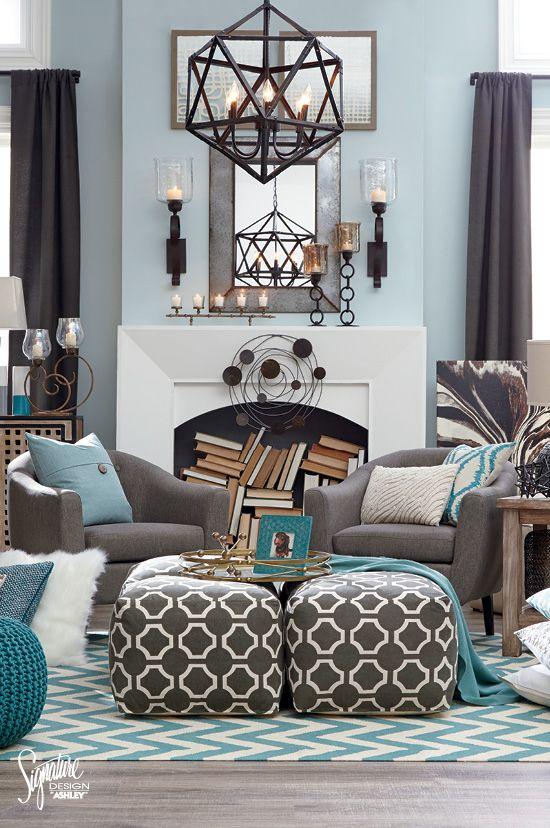 """#AshleyFurniture - Spice up your living room with shades of gray, teal and white! Push two poufs together for a longer """"table"""" look, mix and match patterns and don't forget to have fun creating your own unique style! Ashley Furniture - Living Room Furniture Ideas - Accessories"""