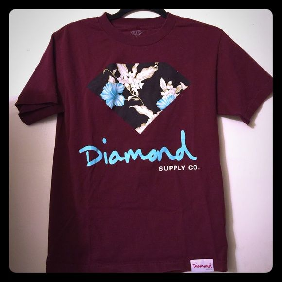 Women Diamond supply co burgundy t shirt VERY GOOD CONDITION. Used to be one of my favorite shirts but I'm over the brand and I switched my style up but it's in good condition. Very thick material. Small but could fit an extra small I'm sure cause I'm sure it shrunk. Diamond Supply Co Tops Tees - Short Sleeve
