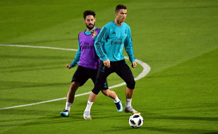 Cristiano Ronaldo Photos - Real Madrid's Portuguese forward Cristiano Ronaldo (R) vies for the ball against his Spanish midfielder teammate Isco during a training session two days prior to their FIFA Club World Cup semi-final match at New York University Abu Dhabi's stadium in the Emirati capital on December 11, 2017. / AFP PHOTO / GIUSEPPE CACACE - Real Madrid Training in Abu Dhabi Before Their FIFA Club World Cup Semi-Final