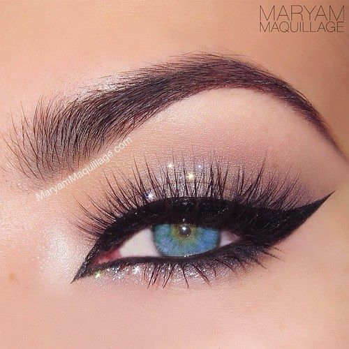 Dramatic cat eye winged liner with silver glitter #eye #eyes #makeup #eyeshadow #dramatic #bold