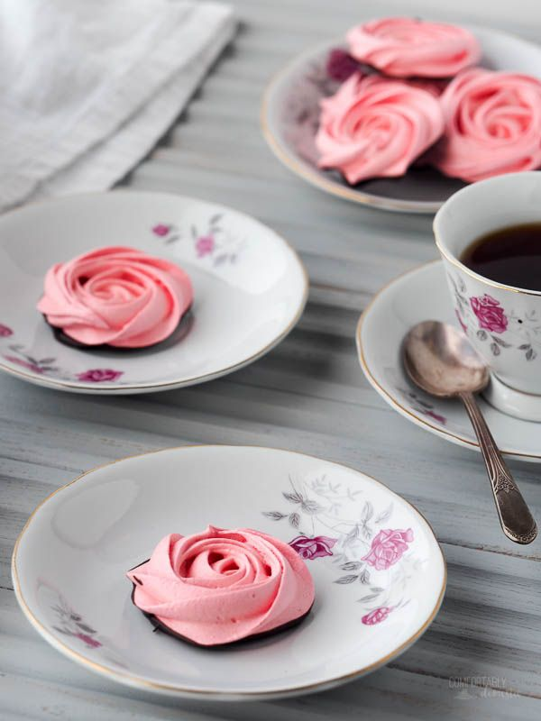 Rose-Meringue-Cookies are crisp, light, and airy cookies in the shape of sweet roses. A swirl through dark chocolate makes these low fat cookies a decadent treat! via @comfortdomestic www.comfortablydomestic.com
