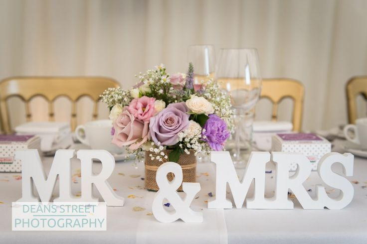Small flower design in dusky lilac and pink for the top table