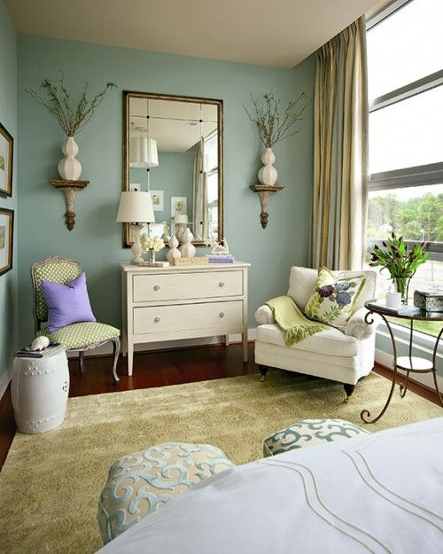 so many things to love - the paint color, the cozy chair, the gold mirror, the garden stool as a side table - so fresh and homey!  (courtesy of www.nancytaylorlynchinteriordesign.com)