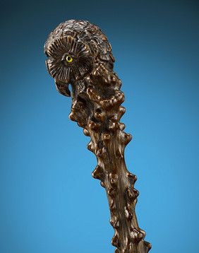 """This important and rare folk art cane is carved entirely from a single branch of bloodwood. Bloodwood, or """"sangre"""", earned its name due to its natural protrusions, which have the appearance of blood droplets. Popular among folk art carvings, this wood is used to incredible effect in the present piece, as the striking cane blends the natural textures of the wood with a carved owl's head. Yellow glass eyes complete the remarkable cane.<br><br>France, circa late 19th century<br><br>35 1/2""""…"""