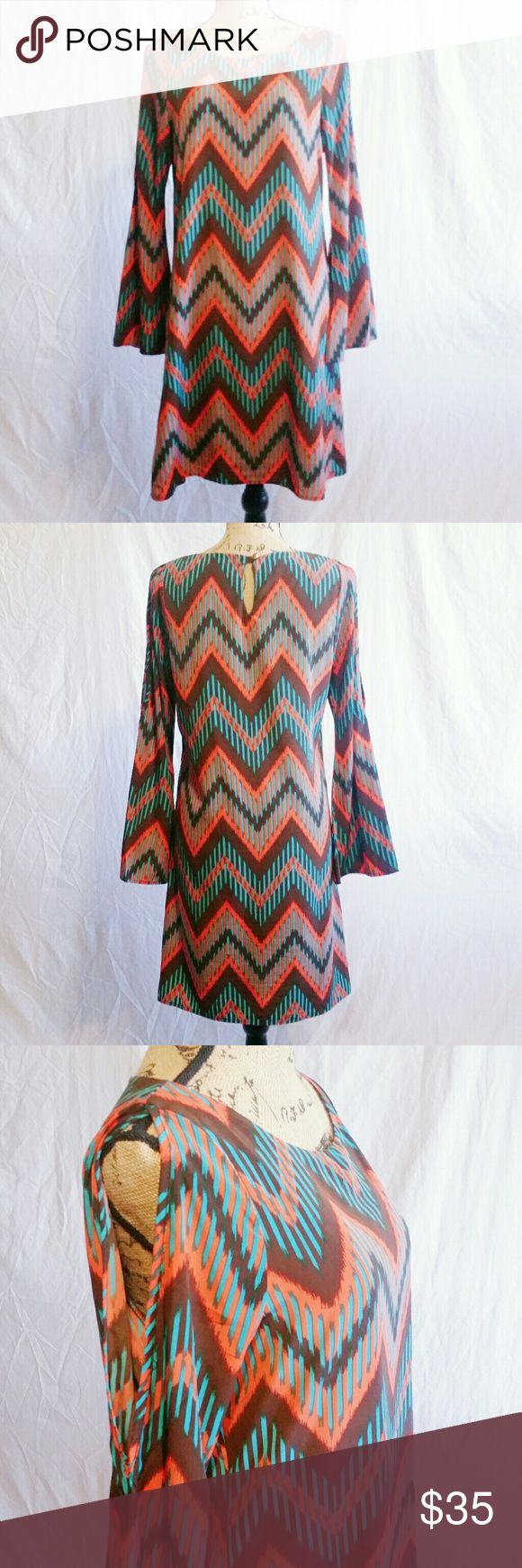 Mint & Coral Chevron Print Dress - Size M (NWOT) Make me an offer! Be noticed in this vibrant colored chevron print Peach Love Cream California scoop neck midi dress. Keyhole button at top on back & sexy sleeve cut-outs that show off those beautiful shoulders! New without Tags. Size Medium. 100% polyester. Hand wash cold & hand to dry. Dresses Midi