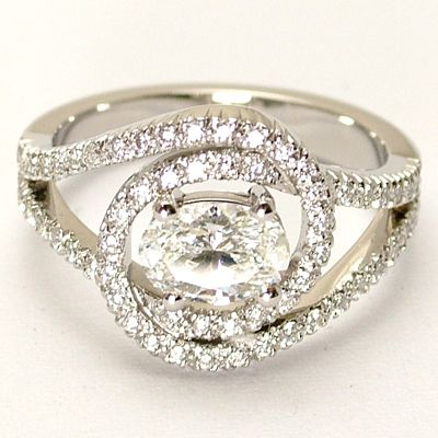 Unique Engagement Ring, Handmade in platinum with an oval diamond centre and cutdown pave diamonds in a split hoop design. *whistles*