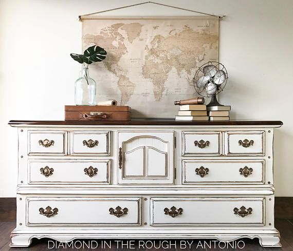PLEASE NOTE SHIPPING IS NOT INCLUDED IN THE PRICE. SEND ME A MESSAGE PRIOR TO PURCHASE WITH YOUR ZIP CODE TO RECEIVE A SHIPPING QUOTE. This vintage Thomasville solid wood dresser was hand painted and distressed in a beautiful white. The top was refinished with a dark stain and