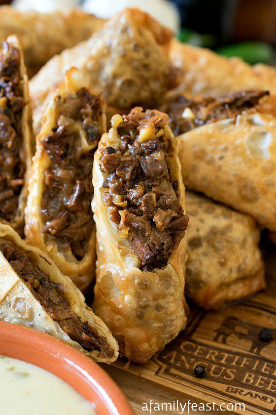 Cheesesteak Egg Rolls!! Tender shredded beef brisket in crispy fried egg rolls, served with a zesty queso dipping sauce. Amazing!