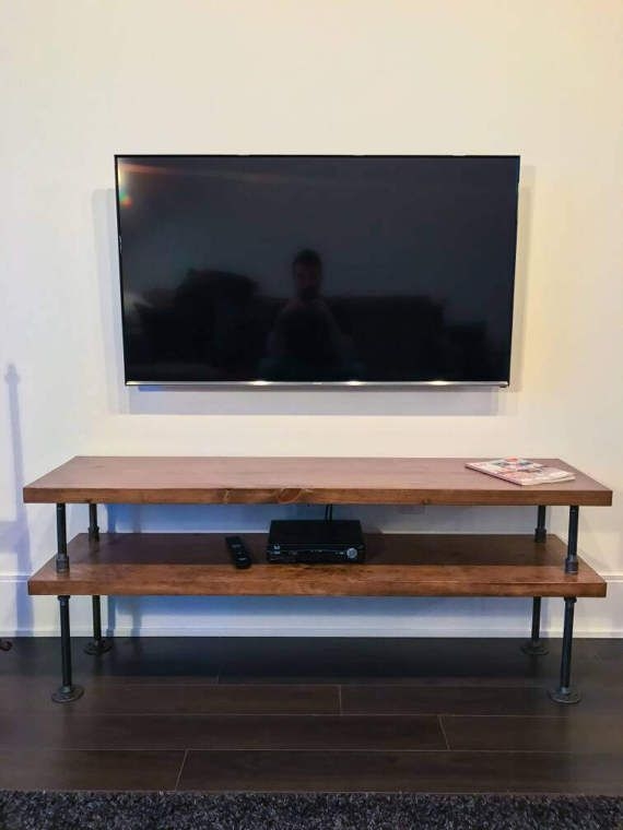 Rustic industrial gas pipe and pine wood TV shelf/ entertainment unit Beautifully finished with a rustic walnut stain to give it the charming look. Dimensions in photo are roughly 72L x 11.5D x 21H. Unit has ~7 space between shelves, and first shelf is ~11 off the floor. Custom