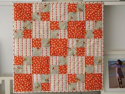 Nice arrangement of squares. Try it in red, white and blue. Or even in gray, white and yellow.