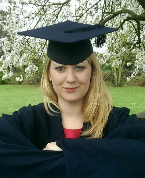 Daughter Katie at her graduation day. Guess she loved wearing the 'Bat Cape'. And no, I do not know where Robin was!!