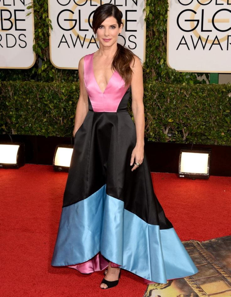 """""""Gravity"""" star Sandra Bullock's red carpet looks have been out of this world, and this dress by Prabal Gurung is no exception. The Golden Globe nominee stunned in blue, pink and black."""
