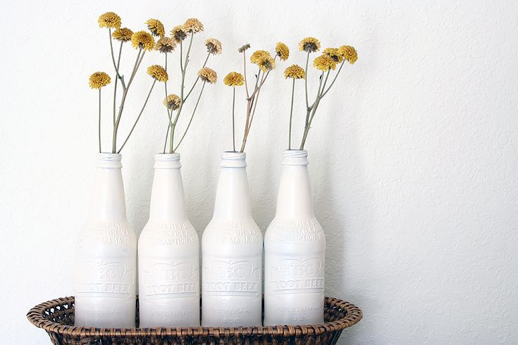 spray paint rootbeer bottles to turn them into vases.