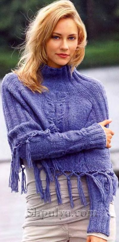 Blue knitted poncho with fringe sleeves and spokes