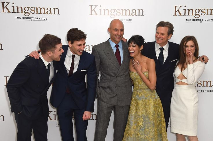 Actors Taron Egerton, Edward Holcroft, Mark Strong, Sofia Boutella, Colin Firth and Sophie Cookson laugh together as they pose for photographers upon arrival...