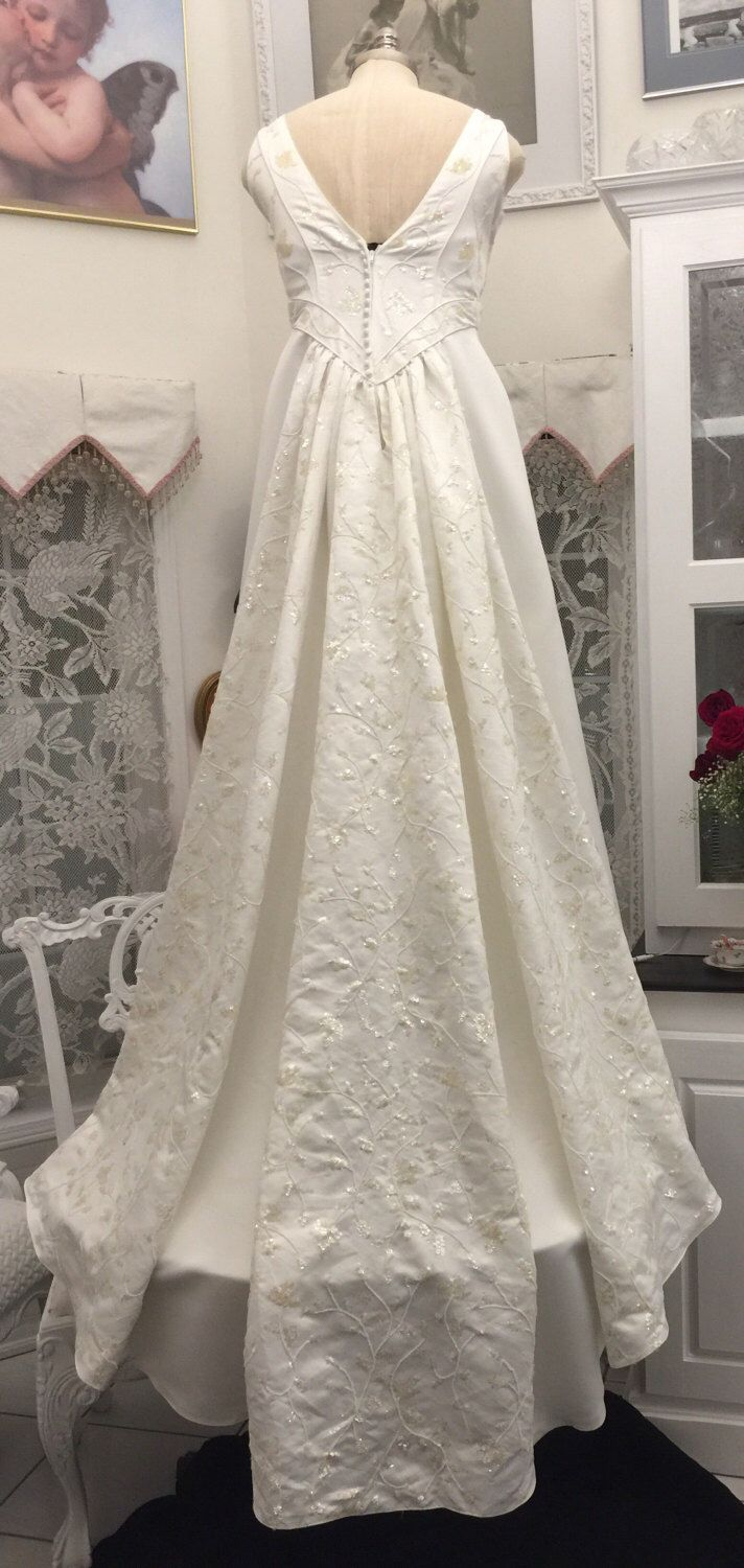 A personal favorite from my Etsy shop https://www.etsy.com/ca/listing/514643997/vintage-oleg-cassini-wedding-gown-size