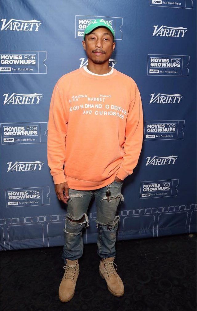 Pharrell Williams Wears a Cactus Plant Flea Market Hat, Sweatshirt, G-Star Raw Jeans and Timberland Boots | UpscaleHype