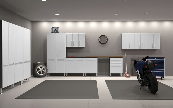 We have never wanted to live in a garage more than we do right now! This garage has the ultimate sleek and cool design that makes you actually want to spend time in this room.