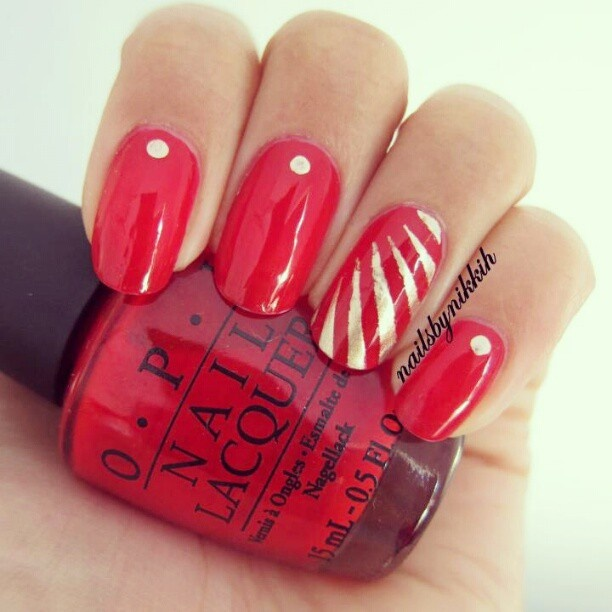 Red and gold accent nail art design in OPI Big Apple Red with gold
