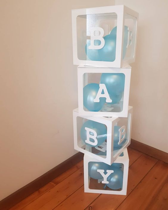 Simple yet stunning balloons in a box BABY SHOWER idea! Blue is the perfect colo…