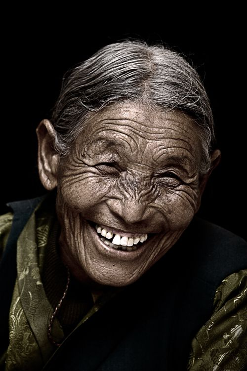 A beautiful Tibetan Smile, old woman, face, wrinckles, aged, lines of Life, cracks in time, beauty, portrait, photo