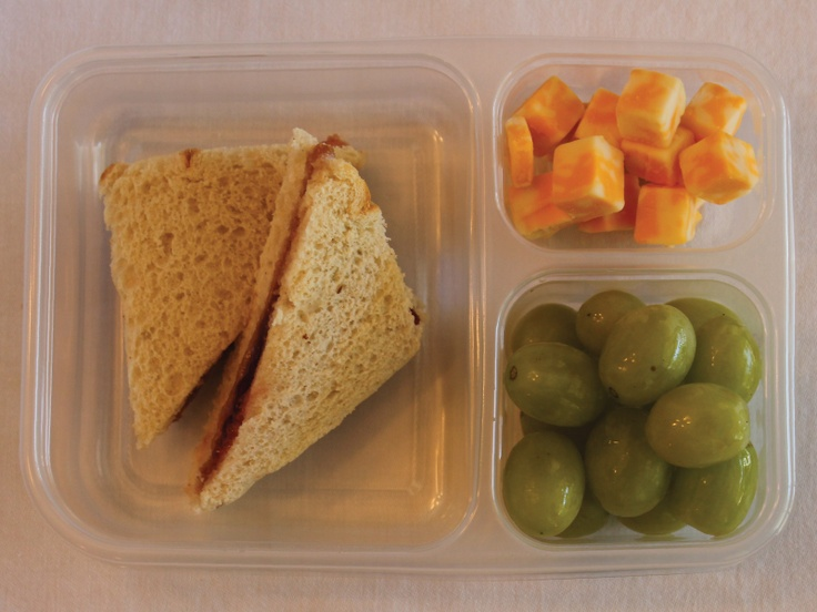 Quick lunch #2: Peanut butter & jelly sandwich, green grapes, and cheese cubes.