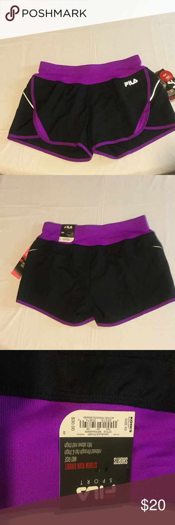 """FILA Sport Storm Running Short. Mid Rise FILA Sport Storm Run Short, Mid Rise, relaxed through hip and thigh, hits above mid thigh.  Size XS.  Pocket to hold essentials.  Panties attached.  Elastic and draw string waist.  TruDry, wicks moisture away from the body to keep you comfortable. Reflective for added visibility.  Stretch Fabric and Flat Seams.  Made in Indonesia of Polyester.  Washer and dryer safe.  14"""" waist seam to seam, FILA Shorts #runningessentials"""