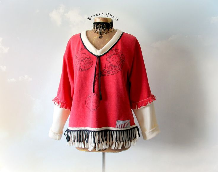 """JOCELYN"" Sweatshirt This roomy fit, one of a kind sweatshirt features fringe on the sleeves and around the bottom. It has a V-neckline..."