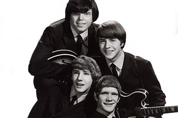 The McCoys: With your long blonde hair And your eyes of blue The only thing I ever got from you Was sorrow Sorrow You acted funny trying To spend my money You're out there playing your high class games of sorrow Sorrow