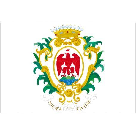 """Le drapeau officiel de la Ville de Nice est en vente chez Kalu Nissa en exclusivité ! celui-ci se compose de l'aigle rouge sur les 3 collines, surmonté de la couronne et entouré des palmes vertes sous lesquelles est inscrit """"Nicaea Civitas"""", qui signifie en latin, Ville de Nice. Dimension 150x100 cm / Tarif 30€."""