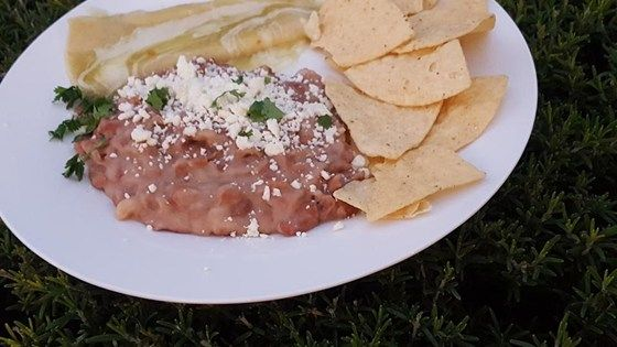 The secret to these frijoles refritos, or refried beans, is that they are slow cooked to perfection over six hours, then quickly fried in oil.