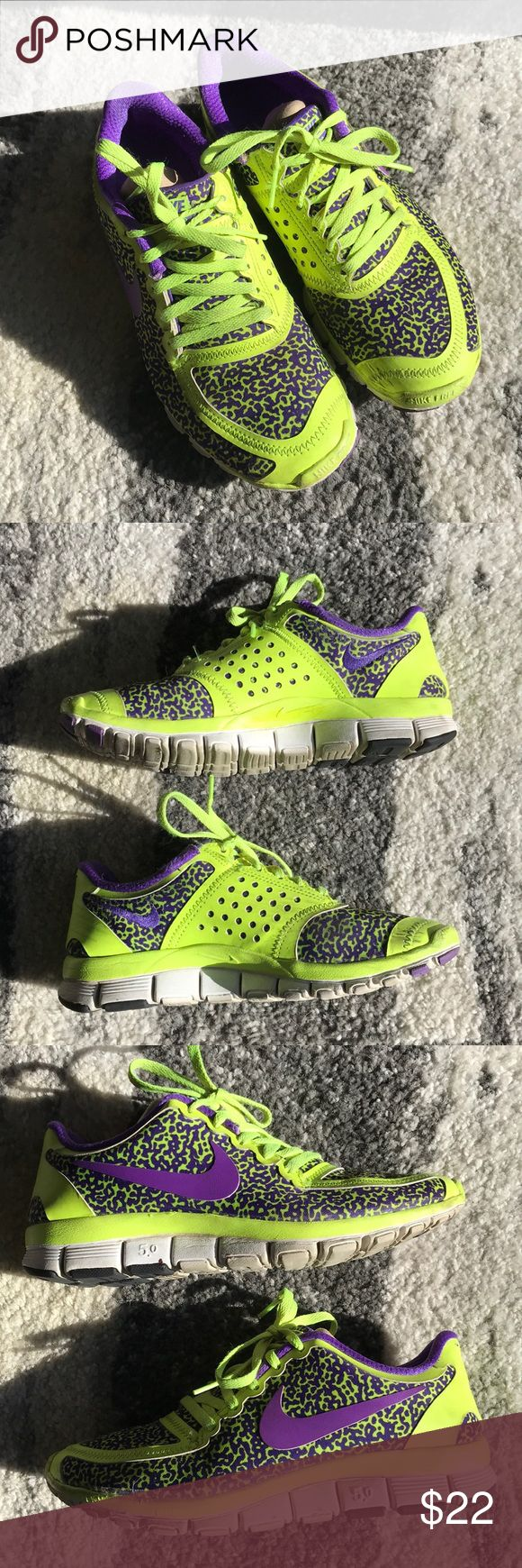 Nike Free 5.0 Sneakers - Women's size 6.5 Purple and volt leopard print Nike Free's. Some wear to the soles but still a lot of life left. Left shoe has a small hole on right side of ankle (see photo). Not very noticeable when on feet. I do not have the original box. Nike Shoes Athletic Shoes