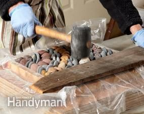 Dry mortar stepping stones from The Family Handyman magazine (Photo 4: Tamp the stones level to the tops)