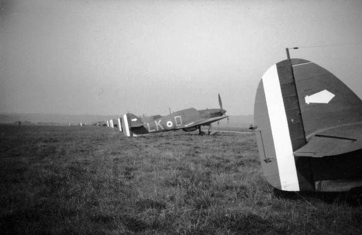 Hurricane Mk I fighters of No 87 Squadron RAF are lined up at Seclin in April 1940. Tests conducted during the 1930s convinced the RAF that the speed of modern aircraft would limit the amount of time for which a fighter pilot could hold a target in his sights. In 1937, the firepower was enough to outgun the early Me 109 variants. By 1940, it was recognised that the relatively small calibre armament was inadequate as Luftwaffe aircraft could survive numerous hits and still return safely to…