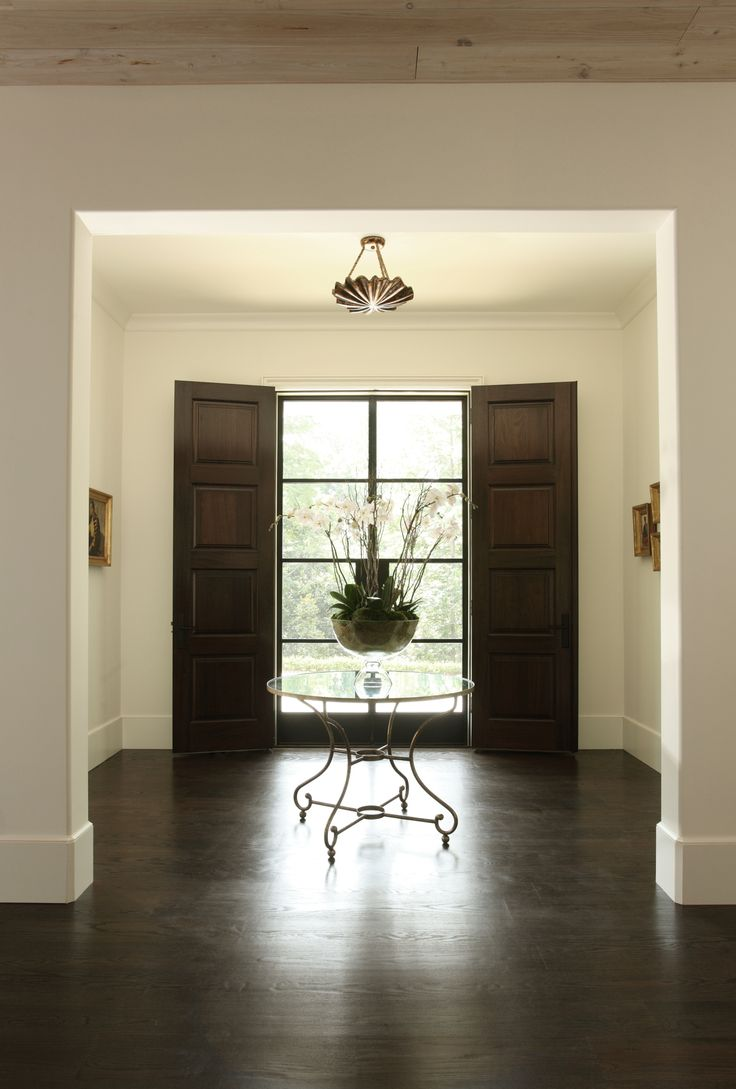 Double front doors, one set in steel and one in wood provides the best of both worlds. Hedgewood custom home.