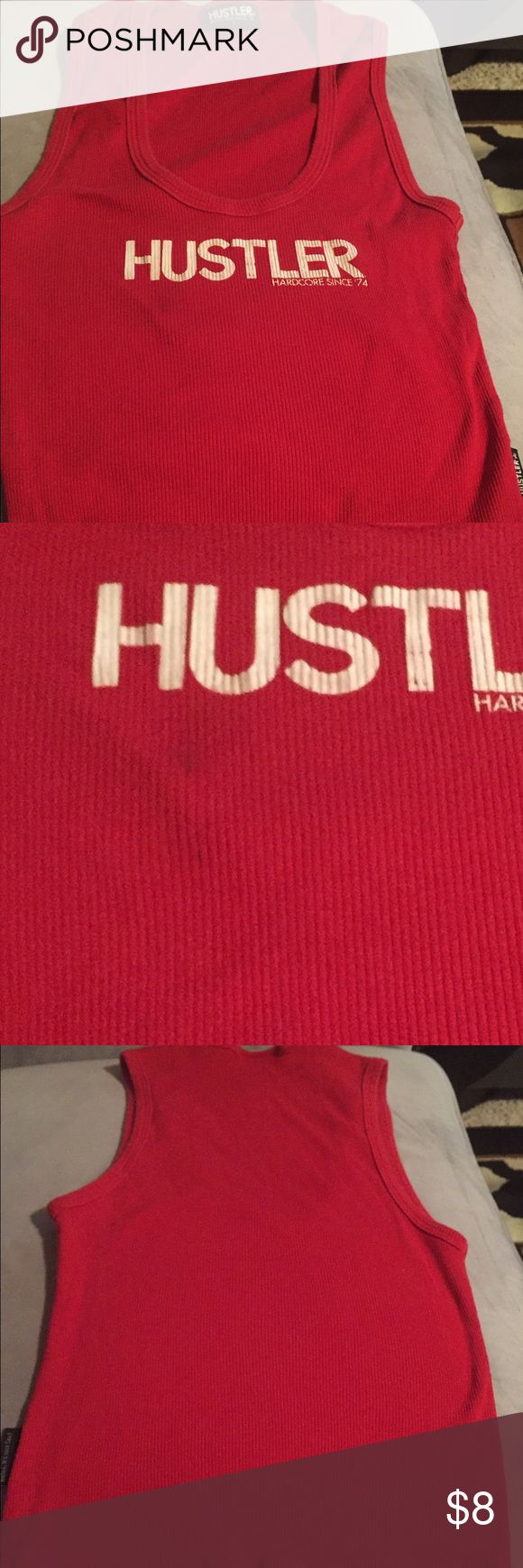 Hustler tank top Hustler tank top. Does have a small stain on shirt (2nd pic). hustler Tops Tank Tops