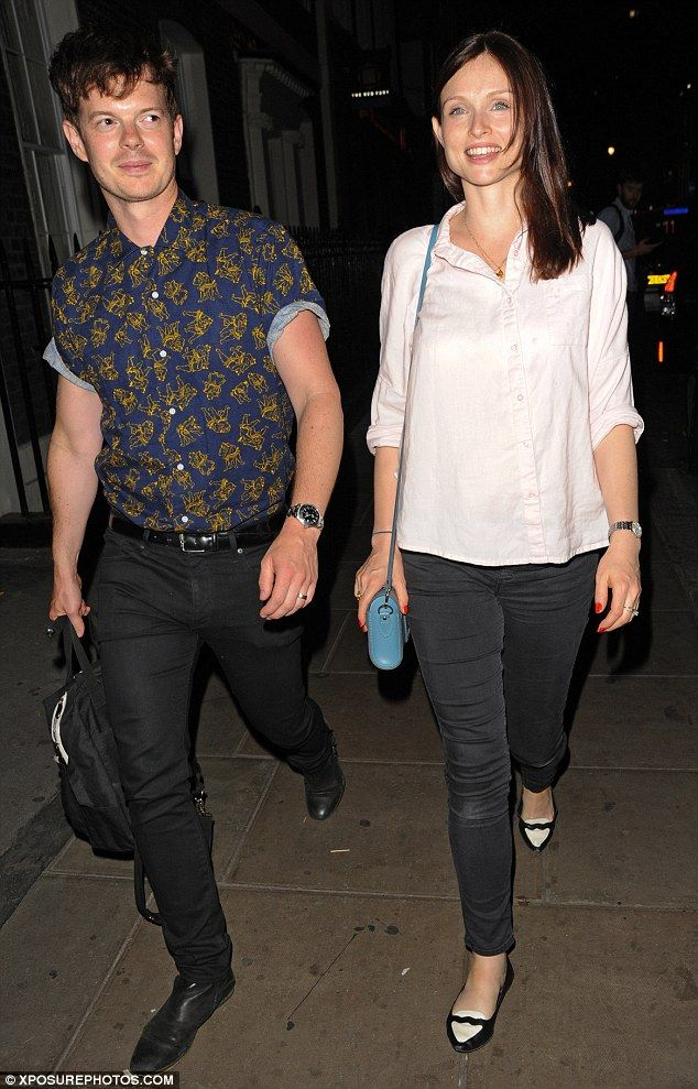 Date night: Pregnant Sophie Ellis Bextor, 36, covered her growing baby bump in a loose-fitting light pink shirt as she headed to Soho House in London with husband Richard Jones on Wednesday